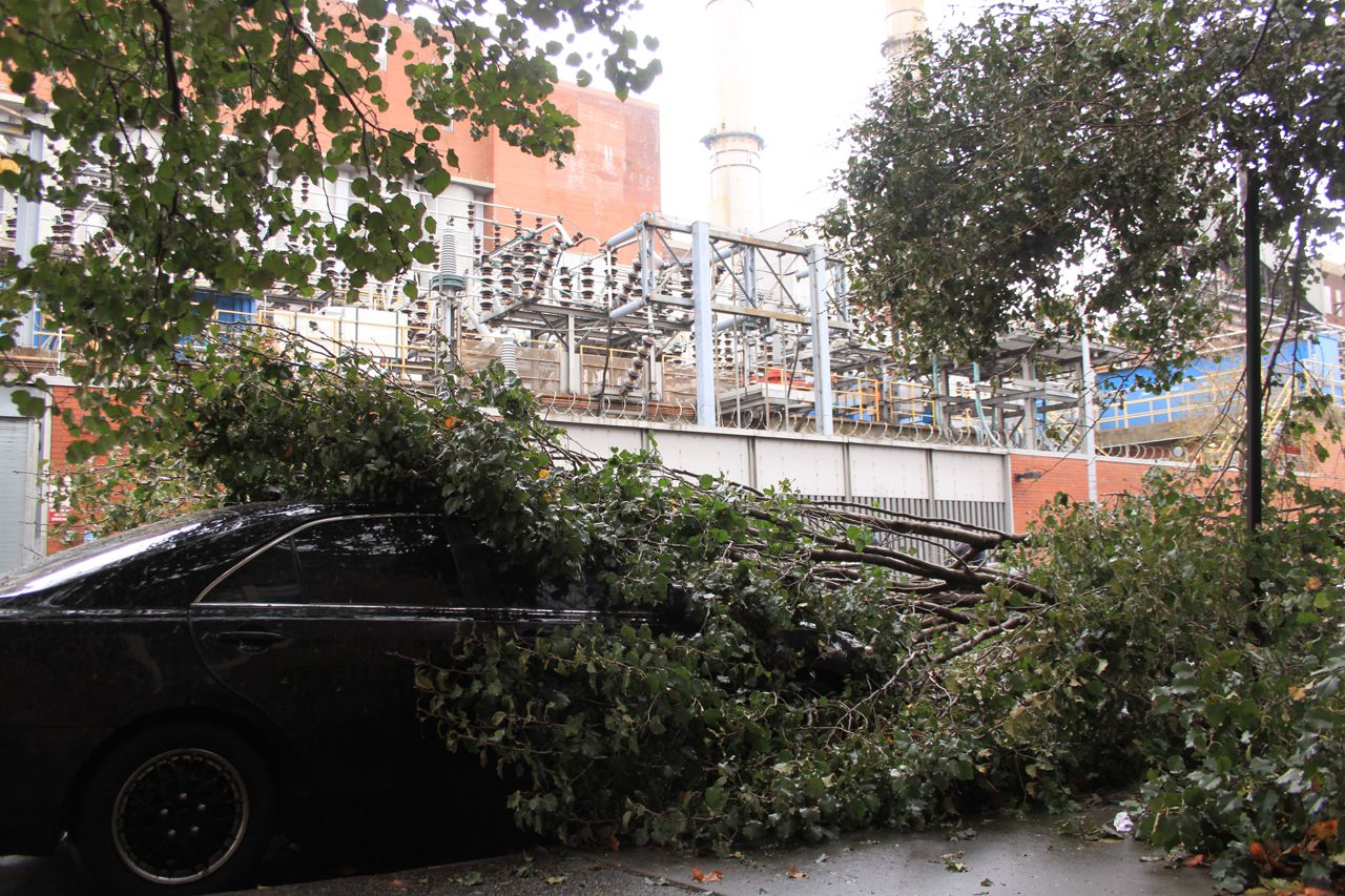 Fallen trees and crushed cars surrounding manhattan's con edison on the lower east side