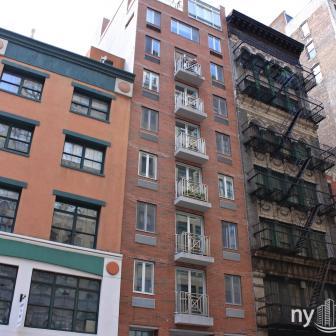 82 University Place next to NYU