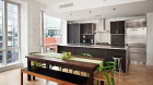 urban_glass_house_dining_area_and_kitchen.jpg